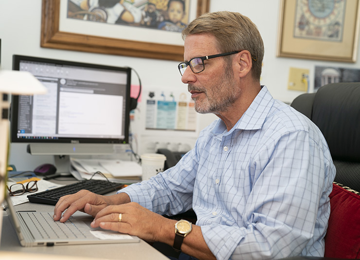 Robin Jenkins working at his computer