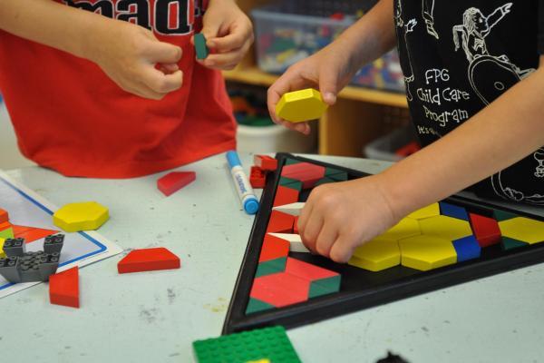 Children doing puzzle