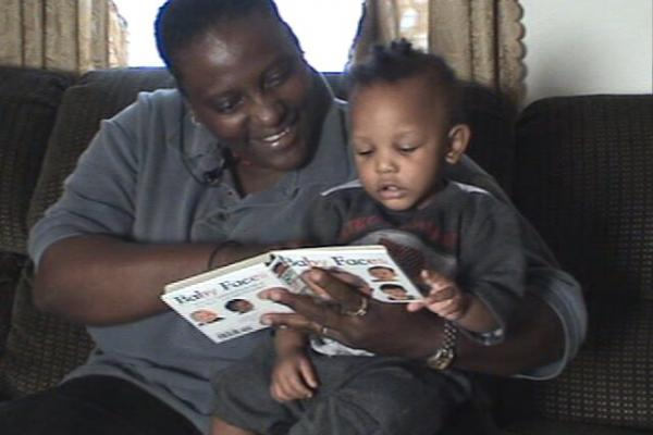 Father reading with young child