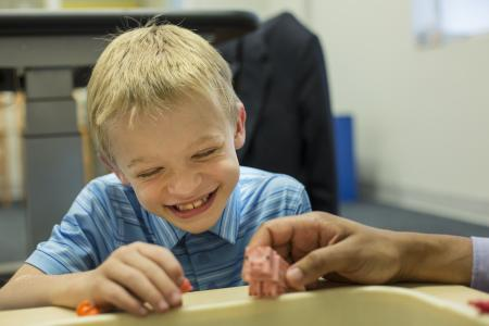 Smiling boy in classroom